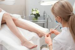 Pedicure in a Day Spa, feet nails Stock Photos
