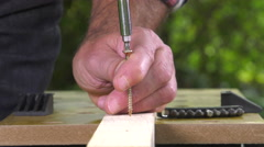 laying a wood screw with an electric screwdriver - stock footage