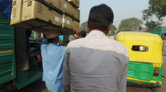 Ride on a rickshaw in crowded traffic of Old Delhi, India - stock footage