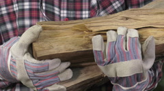 Handyman with oak logs in the arms Stock Footage