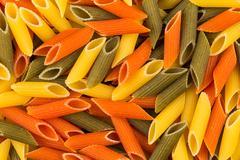 Three color penne pasta - stock photo