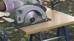 Cutting a panel with a circular saw Stock Footage