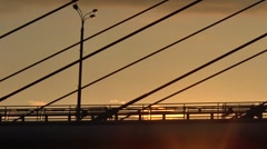 Two bicycle drive on bridge in sunset time Stock Footage