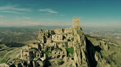 Aerial video of a destroyed and abandoned village on a mountain. N. Stock Footage