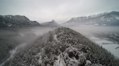 Aerial view: Snowy and foggy valley. Misterious place. Stock Footage