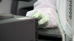 Typing Computer Keyboard with latex gloves in an pharmacy lab Stock Footage