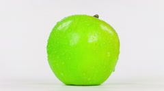 Wet green apple, isolated on white background, close-up rotation. Stock Footage