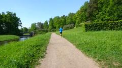 man Jogging in summer Park - stock footage