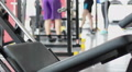 Active people working out in gym, exercising on sports equipment, gym atmosphere Footage