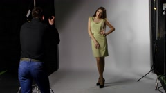 Photomodel and photographer. Photoshoot in the Studio in profile. Spot light - stock footage