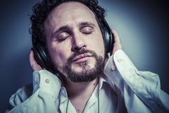 Classical music, man with intense expression, white shirt Kuvituskuvat