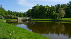 Lake and bridge in the summer Park - stock footage