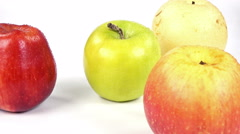 Yellow, green, red and fuji apples on white background close-up rotation. Stock Footage