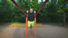 Muscular man during his workout in park. Dips, exercise chest and triceps - stock footage