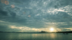 timelapse of gray winter rain clouds over sea beach bay. 4K. - stock footage