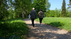 People doing Nordic walking in Park - stock footage