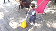 Little sweeper on the job Stock Footage