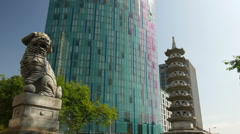 Chinese pagoda and lion near Chinatown in Birmingham, England. Stock Footage