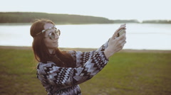 Smiling woman dressed in boho style doing selfie phone. Stock Footage