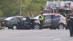 Deadly fatal head on car crash in city of Toronto intersection Stock Footage