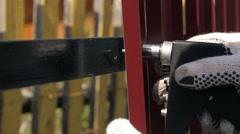Repair the metal fence in village Stock Footage