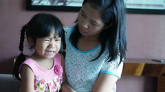 Little girl crying and her mother talking teaching to be good. - stock footage
