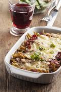 Pasta casserole on dark wood Stock Photos