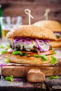 Homemade burger with beef cutlet, apple, lettuce, onion and blue cheese Stock Photos