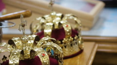 Close up of two gold wedding crowns Stock Footage