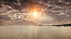 Fishing boat and sun rises or sunset with light ray through cloud running. Stock Footage