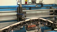 Robot assembling parts of a car door - stock footage
