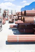 Stack of steel pipes for scaffolding in stock. Stock Photos