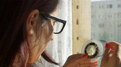 Woman Looking on 8 mm Reel Stock Footage