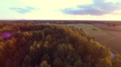 Beautiful sunset at fields. Trees tops. Aerial footage. - stock footage