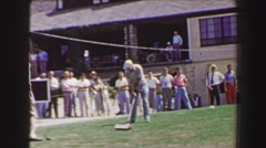 1968: Professional golf tournament tees off on 1st hole at clubhouse, crowd Stock Footage