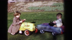 1957: Boy girl riding vintage antique toy pedal car in front lawn. DAVENPORT, Stock Footage