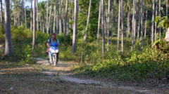 Young Man Riding Motor Scooter Along Country Road. Stock Footage
