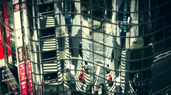 Tokyo - Aerial view of junction, people and traffic reflecting in glass building Stock Footage