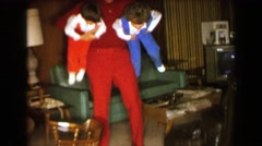 1957: Grandpa's wild spinning dizzy hurricane child care playtime. DAVENPORT, - stock footage