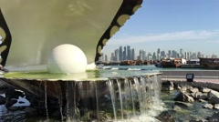 The Pearl Monument and fountain located along the Dhow Harbour Stock Footage