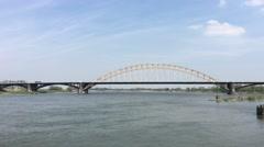The Waalbridge over the Waal river in Nijmegen Stock Footage