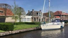 Sailing through IJlst, Friesland The Netherlands Stock Footage