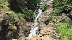 People walking at the Rawana falls in Ella Sri Lanka Stock Footage