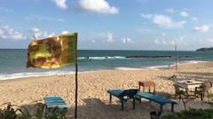 Sri lankan flag at Tangalle beach Stock Footage