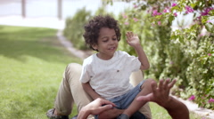 Father with son having fun at park. Stock Footage