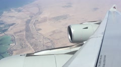 Qatar Airlines flying over the United Arab Emirates Stock Footage
