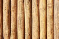 Solid wood backgroung texture of whole logs - stock photo