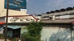 View from the train passing by old houses Stock Footage