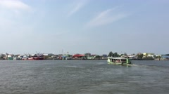 Ferry over the Tha Chin from Samut Nakhon to Tha Chalom - stock footage