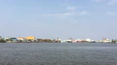 View from a ferry over the Tha Chin from Samut Sakhon to Tha Chalom Stock Footage